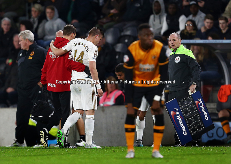 Franck Tabanou of Swansea City leaves the game through injury during the Capital One Cup match between Hull City and Swansea City played at the Kingston Communications Stadium, Hull