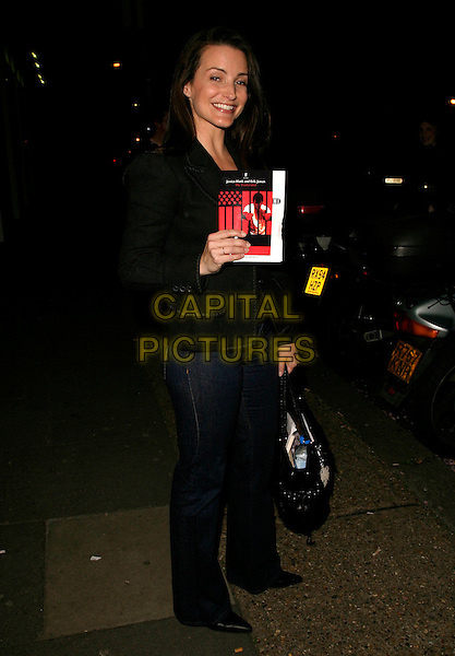 """KRISTIN DAVIS.Leaving Riverside Studios, Hammersmith, where she had been a guest performer in the play """"The Exonerated"""", London, England, May 2nd 2006..kristen full length jeans black jacket programme.REf: AH.www.capitalpictures.com.sales@capitalpictures.com.©Adam Houghton/Capital Pictures."""