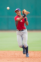 Shortstop Francisco Lindor #12 makes a throw to first base during the USA Baseball 18U National Team Trials at the USA Baseball National Training Center on June 30, 2010, in Cary, North Carolina.  Photo by Brian Westerholt / Four Seam Images