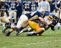 30 September 2006: Pitt linebackers Brian Bennett (44) and H.B. Blades (right) put a hard hit on a Toledo ball carrier.  The Pitt Panthers defeated the Toledo Rockets 45-3 on September 30, 2006 at Heinz Field, Pittsburgh, Pennsylvania.