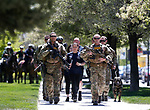 Carson City Sheriff's SWAT members escort memorial baton carriers Rhonda Gierczic, Rhonda Adams and Bryan Zink into the 22nd annual Nevada Law Enforcement Officers Memorial ceremony in Carson City, Nev., on Thursday, May 2, 2019. <br /> Photo by Cathleen Allison/Nevada Momentum