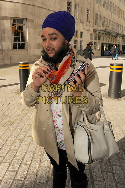 LONDON , ENGLAND - FEBRUARY 21 ; Harmaam Kaur a 23 year old female who has been baptised a Sikh leaving BBC Centre on February 21st in London , England.<br /> CAP/IA<br /> &copy;Ian Allis/Capital Pictures