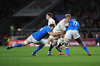 Joe Launchbury of England is tackled by David Sisi and Cherif Traore of Italy during the Guinness Six Nations match between England and Italy at Twickenham Stadium on Saturday 9th March 2019 (Photo by Rob Munro/Stewart Communications)