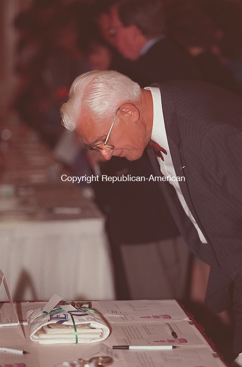 WATERBURY, CT 10/17/98- Perry Pettinicchi from Waterbury, takes a closer look at watch from The American Walthan Watch Company, while attending a silent auction at the Greater Waterbury Chapter of the American Red Cross. The annual fall gala included a performance from Joey and Maria's Comedy Wedding along with dinner at the Sheraton Four Points Hotel in Waterbury.