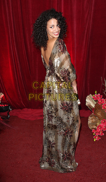 HOLLY QUIN-ANKRAH.British Soap Awards 2010 at the London ITV Studios, South Bank, London, England..May 8th 2010.arrivals full length beige gold dress brown red maroon floral print dress v looking over shoulder .CAP/ROS.©Steve Ross/Capital Pictures.