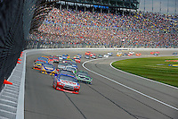 Polesitter A. J. Allmendinger (#22) pulls away from the field at the drop of the green flag.
