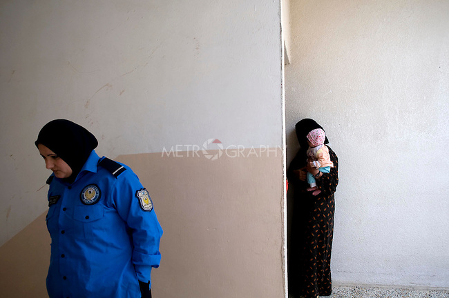 SULAIMANIA, IRAQ: Prison guard leaves the room to allow a female detainee to meet with Rezan.  The woman told the lawyer that her husband severely abused her and that she is accused of killing him.