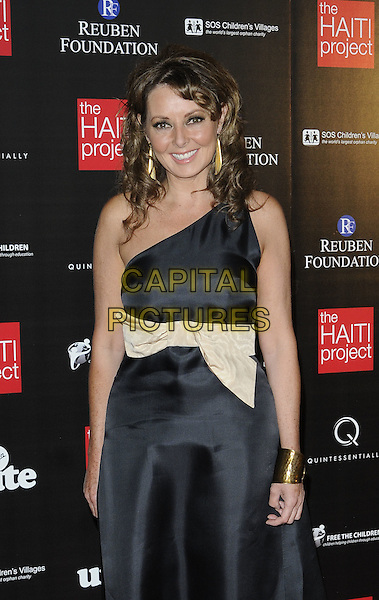 CAROL VORDERMAN .At The Reuben Foundation Haiti Fundraiser, Attitude 360, Millbank Tower, London, England, UK, .May 26th 2010..half length gold cuff bracelet one shoulder black dress cream bow sash .CAP/CAN.©Can Nguyen/Capital Pictures.
