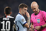 Kieran Trippier of Atletico Madrid holds his nose as referee Anthony Taylor puts his pens away with Paulo Dybala of Juventus pictured in the background during the UEFA Champions League match at Juventus Stadium, Turin. Picture date: 26th November 2019. Picture credit should read: Jonathan Moscrop/Sportimage