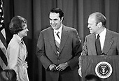 United States President Gerald R. Ford, right, and first lady Betty Ford, left, are photographed with US Senator Bob Dole (Republican of Kansas) in Kansas City, Missouri after the Chief Executive named him as his running mate in the 1976 Presidential election on August 18, 1976.  Both men will be running on the Republican ticket.<br /> Credit: Arnie Sachs / CNP