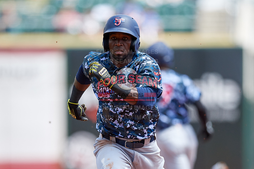 Jacksonville Jumbo Shrimp left fielder Jeremias Pineda (20) retreats to first base during a game against the Birmingham Barons on April 24, 2017 at Regions Field in Birmingham, Alabama.  Jacksonville defeated Birmingham 4-1.  (Mike Janes/Four Seam Images)