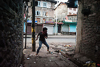 Srinagar, India-August 7, 2010: A Kashmiri protester prepare to throw a rock at Indian police and military in downtown Srinagar