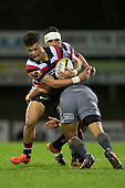Nathan De Thierry gets tackled by Lima Sopoaga. The game of Three Halves, a pre-season warm-up game between the Counties Manukau Steelers, Northland and the All Blacks, played at ECOLight Stadium, Pukekohe, on Friday August 12th 2016. Photo by Richard Spranger.