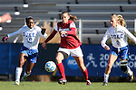 24 November 2013: Arkansas' Lindsey Mayo (25) is chased by Duke's Natasha Anasi (4) and Kaitlyn Kerr (5). The University of Arkansas Razorbacks played the Duke University Blue Devils at Koskinen Stadium in Durham, NC in a 2013 NCAA Division I Women's Soccer Tournament Third Round match. Duke advanced by winning the penalty kick shootout 5-3 after the game ended in a 2-2 tie after overtime.