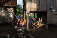 June 03, 2014 - Kampong Thom, Cambodia. A man fries crickets for sale in the early mornings. © Nicolas Axelrod / Ruom