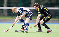 Will Naylor (L) of Hampstead is challenged by Stephen Lawrence during the HA Mens Cup Semi-Final between Hampstead & Westminster and Beeston at the Paddington Recreation Ground, Maida Vale on Sun March 20, 2011