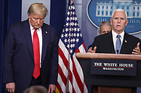 United States Vice President Mike Pence speaks as US President Donald J.Trump listens during a press conference with members of the coronavirus task force in the Brady Press Briefing Room of the White House on March 24, 2020 in Washington, DC.<br /> Credit: Oliver Contreras / Pool via CNP/AdMedia