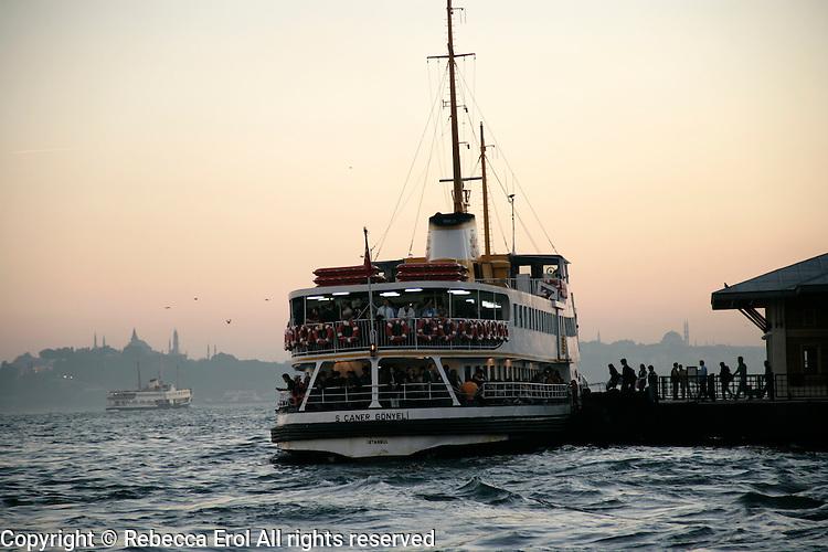 Passengers board a ferry at Besiktas, Istanbul, Turkey