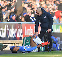Manchester City's Manager Pep Guardiola with an injured  Huddersfield Town's Juninho Bacuna<br /> <br /> Photographer Dave Howarth/CameraSport<br /> <br /> The Premier League - Huddersfield Town v Manchester City - Sunday 20th January 2019 - John Smith's Stadium - Huddersfield<br /> <br /> World Copyright © 2019 CameraSport. All rights reserved. 43 Linden Ave. Countesthorpe. Leicester. England. LE8 5PG - Tel: +44 (0) 116 277 4147 - admin@camerasport.com - www.camerasport.com