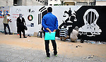 Palestinian youths draw a mural as part of a popular campaign to demand the inheritance rights of women in Gaza City on November 27, 2013. Reports of human rights in Gaza Strip pointed out that about 90% of the women who marry men from outside their family accept only a small portion of their inheritance due to their ignorance of the law or in a bid to avoid problems with their siblings. Furthermore, only 10% of them go to court to have their rights upheld or resort to reconciliation committees to resolve the problem amicably. Photo by Mohammed Talatene
