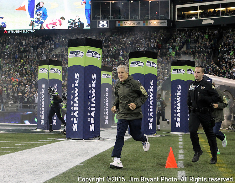 Seattle Seahawks  head coach Pete Carroll runs onto the field before their game against the Arizona Cardinals at CenturyLink Field in Seattle, Washington on November 15, 2015. The Cardinals beat the Seahawks 39-32.   ©2015. Jim Bryant photo. All Rights Reserved.