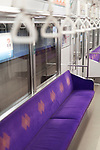 JR train interior with empty purple seats in Kyoto, Japan 2017