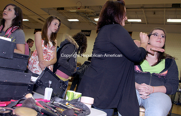 WOODBURY CT.-16 APRIL 2010-041510DA04- Allie Fazio a senior at Nonnewaug High School has her makeup put on for her by Gina M. Rioux Gabriel during a annual Career Fair at in Woodbury