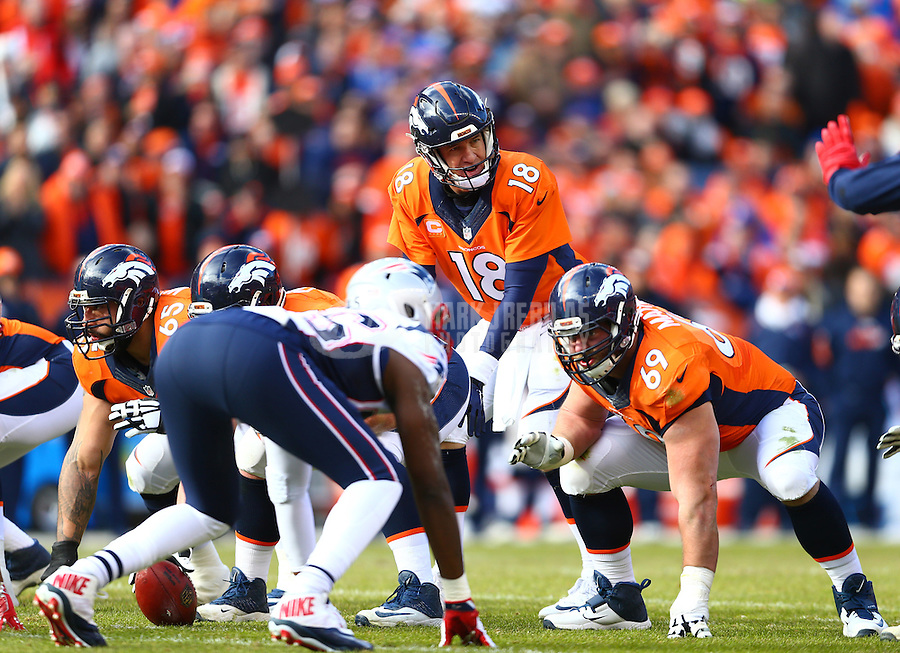Jan 24, 2016; Denver, CO, USA; Denver Broncos quarterback Peyton Manning (18) against the New England Patriots in the AFC Championship football game at Sports Authority Field at Mile High. The Broncos defeated the Patriots 20-18 to advance to the Super Bowl. Mandatory Credit: Mark J. Rebilas-USA TODAY Sports