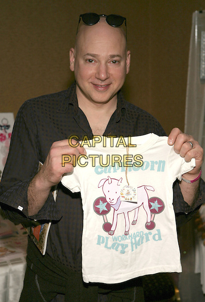 EVAN HANDLER .Boom Boom Room?s Children?s Gifting Wonderland presented by Born Free and Baskin Robbins held at the Century Plaza Hotel, Century City, California, USA..January 9th, 2009.half length black brown shirt white capricorn work hard play.CAP/ADM/TC.©T. Conrad/AdMedia/Capital Pictures.