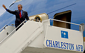 Charleston, AFB, SC - July 24, 2007 -- United States President George W. Bush waves to the crowd from Air Force One on the Charleston Air Force Base, South Carolina flightline on Tuesday, July 24, 2007. President Bush visited Charleston AFB, took a tour of a static C-17, ate lunch with Airmen from the base and talked about the Global War on Terrorism.  <br /> Mandatory Credit:  Nicholas J. Pilch - USAF via CNP