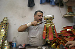 "A picture taken on April 26, 2018 show an Egyptian man manufactures traditional lanterns known in Arabic as ""Fanous"", ahead of the holy Muslim month of Ramadan in Cairo, Egypt. Ramadan is sacred to Muslims because it is during that month that tradition says the Koran was revealed to the Prophet Mohammed. The fast is one of the five main religious obligations under Islam. Muslims around the world will mark the month, during which believers abstain from eating, drinking, smoking and having sex from dawn until sunset. Photo by Amr Sayed"
