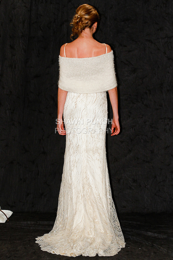 Model walks in a wedding gown from the Anne Bown Bridal Autumn Winter 2014 collection, during New York Bridal Fashion Week, on April 10, 2014.