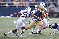 Annapolis, MD - September 9, 2016: Navy Midshipmen quarterback Will Worth (15) avoids the tackle of Connecticut Huskies safety Anthony Watkins (29) during game between UConn and Navy at  Navy-Marine Corps Memorial Stadium in Annapolis, MD. September 9, 2016.  (Photo by Elliott Brown/Media Images International)