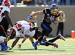BROOKINGS, SD - OCTOBER 22:  Brady Mengarelli #44 from South Dakota State University slips out of the grasp of Jamar Pinnock #6 from Youngstown State in the first half of their game Saturday afternoon at Dana J. Dykhouse Stadium in Brookings. (Photo by Dave Eggen/Inertia)