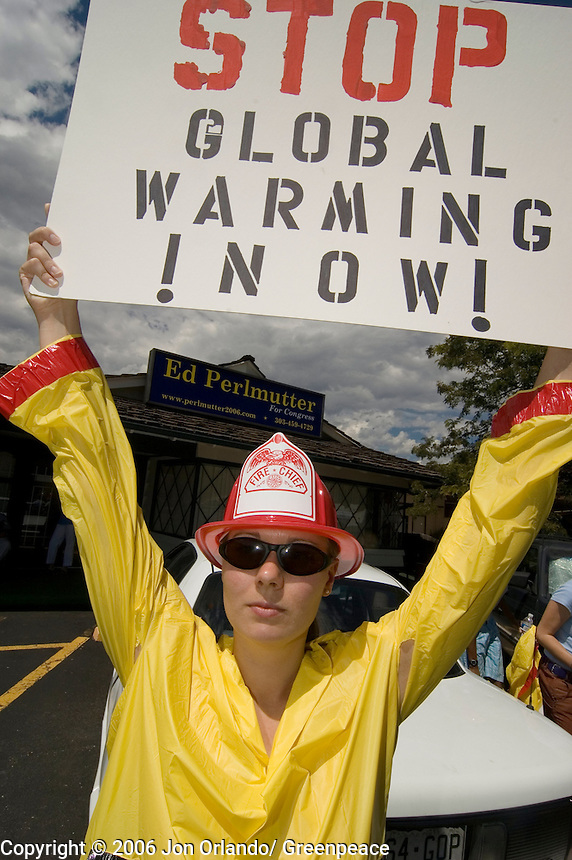Greenpeace activist, Julianne Garrison,  at a rally to raise awareness of the threats of global warming, outside the headquarters of Ed Perlmutter, a Democratic congressional  candidate for district 7 in Colorado.