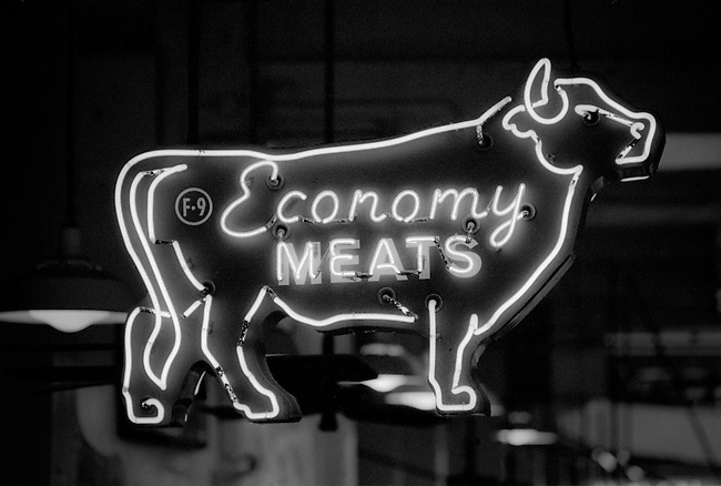 Economy Meats neon sign in the Grand Central Market on South Broadway in downtown Los Angeles, CA (USA)