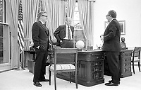 President Gerald R. Ford meeting in the Oval Office with Secretary of State Henry Kissinger and Vice President Nelson Rockefeller to discuss the American evacuation of Saigon. 28 April 1975