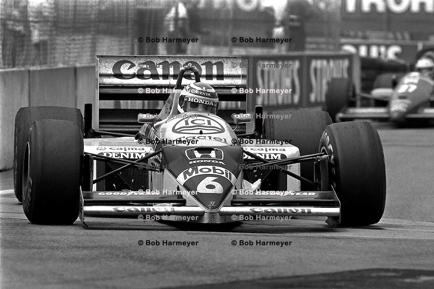 DETROIT, MI - JUNE 22: Nelson Piquet of Brazil drives the Williams FW11/Honda RA166E during the Detroit Grand Prix FIA Formula One World Championship race on the Detroit Street Circuit in Detroit, Michigan, on June 22, 1986.