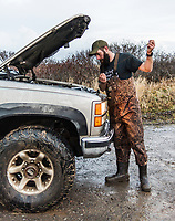 The Chevy truck of Guide and owner of Four Flyways Outfitters Jeff Wasley gets stuck in a river while traveling to a hunting location in Cold Bay, Alaska, Thursday, November 3, 2016. The Izembek National Wildlife Refuge lies on the northwest coastal side of central Aleutians East Borough along the Bering Sea. Birds hunted include the long tailed duck, the Steller's Eider, the Harlequin, the King Eider and Brant.<br /> <br /> Photo by Matt Nager