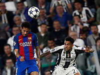Football Soccer: UEFA Champions UEFA Champions League quarter final first leg Juventus-Barcellona, Juventus stadium, Turin, Italy, April 11, 2017. <br /> Barcellona's Neymar (l) in action with Juventus Dani Alves (r) during the Uefa Champions League football match between Juventus and Barcelona at the Juventus stadium, on April 11 ,2017.<br /> UPDATE IMAGES PRESS/Isabella Bonotto