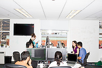 Employees work in the offices of Quantopian in the Downtown Crossing area of Boston, Mass., on Wed., June 1, 2016. Quantopian is a Boston-based start-up that provides a platform for building, testing, and executing stock trading algorithms.