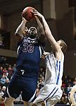 SIOUX FALLS, SD - MARCH 9:  Raheem Bowman #33 of St. Thomas shoots over Briar Cliff defender Austin Roetman #33 at the 2018 NAIA DII Men's Basketball Championship at the Sanford Pentagon in Sioux Falls. (Photo by Dick Carlson/Inertia)