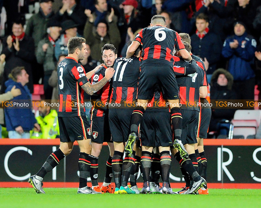 Junior Stanislas of AFC Bournemouth gets mobbed after s during AFC Bournemouth vs Manchester United at the Vitality Stadium