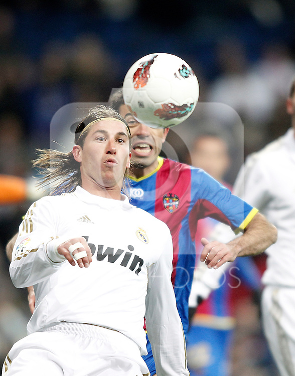 Real Madrid's Sergio Ramos against Levante's Javi Venta during La Liga match. February 12, 2012. (ALTERPHOTOS/Alvaro Hernandez)