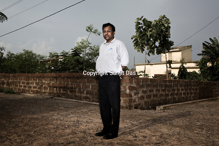 P K Pattanayak, Chief (IR and R&R) TATA Steel Ltd. poses for a portrait in a rehabilitation colony in Kalinganagar, Orissa, India.
