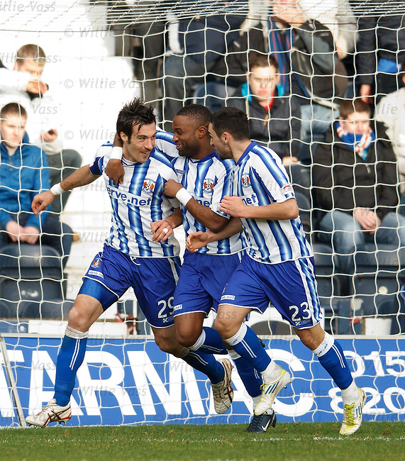 Manuel Pascali celebrates his goal with David Silva and Rory McKeown
