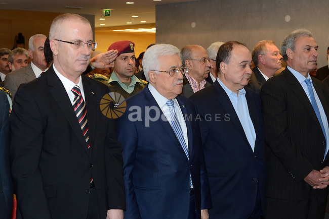 Palestinian President Mahmoud Abbas attends the opening ceremony of museum of late Palestinian leader Yasser Arafat, in the West Bank city of Ramallah November 9, 2014. Arafat's death on November 11, 2004 still remains a mystery with some research indicating he may have been poisoned by polonium, a theory which is accepted by much of the Palestinian street. Photo by Thaer Ganaim