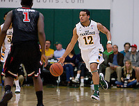Avry Holmes of USF dribbles the ball during the game against St. John's at War Memorial Gym in San Francisco, California on December 4th, 2012.   USF Dons defeated St. John's, 81-65.