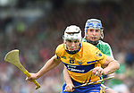 Aron Shanagher of Clare in action against Richie McCarthy of Limerick during their Munster Championship semi-final at Thurles.  Photograph by John Kelly.