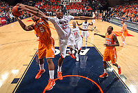 Tennessee forward Jarnell Stokes (5) fights for the rebound with Virginia forward Darion Atkins (32) during the game Wednesday in Charlottesville, VA. Virginia defeated Tennessee 46-38.